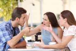 Discussion of three angry friends arguing in a coffee shop