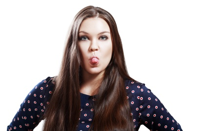 young teen plus size woman shows tongue